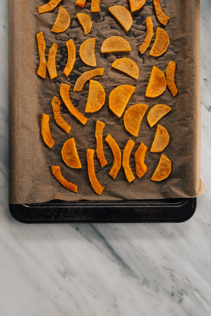 Roasted slices of butternut squash galette on a baking sheet.