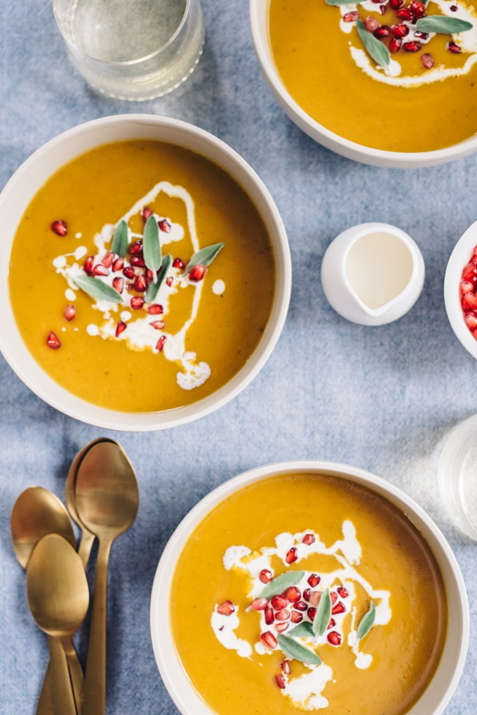 Paleo butternut squash soup with pomegranate seeds is a seasonal nutritional powerhouse. Delicate butternut squash and rich bone broth come together for a velvety soup that is the perfect balance of sweet and savory. Pomegranate seeds add a fun little pop to every bite. This soup is naturally paleo and gluten-free. #wholefood #realfood #paleo #whole30