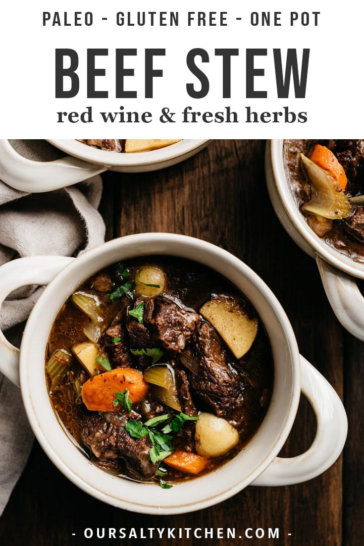 One of the first recipes I reach for when the weather gets cold is a hearty one pot meal, like this classic red wine beef stew braised in a dutch oven with vegetables, fresh herbs, and lots of dry red wine. This rich and decadent Sunday dinner recipe is so full of flavor, incredibly satisfying, and naturally paleo and gluten free. It's the ultimate healthy comfort food to feed (and impress!) a crowd. #beef #stew #paleo #glutenfree #onepot
