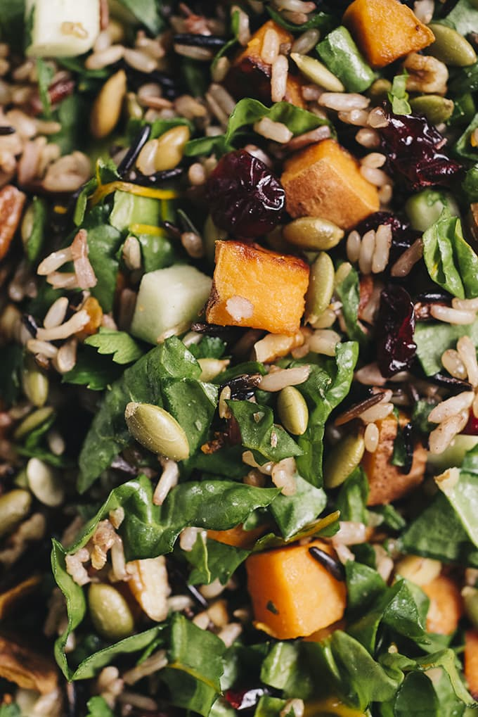 This roasted sweet potato salad with maple vinaigrette is bursting with fall harvest flavor! Roasted sweet potatoes, crisp apples, tender swiss chard, and nutty wild rice come together for a hearty, nutritious, and flavor-packed vegetarian dinner.