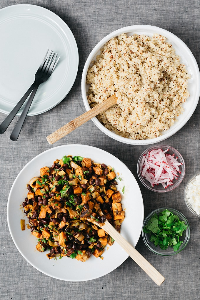 These citrus black beans are fun twist on black beans and rice. I season them with lots of spices and a bit of fresh orange juice, then add some sweet potatoes and serve it all over quinoa. It's a simple, fast and satisfying weeknight meal the whole family loves.