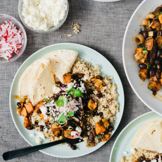 I love this variation of classic black beans and rice. It's made with citrus-seasoned black beans and sweet potatoes over quinoa. It's a simple, fast and satisfying weeknight meal the whole family will love.