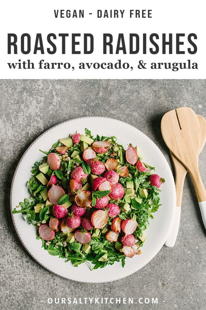Farro and roasted radish salad with avocado, arugula, and mint salsa verde on a white platter.
