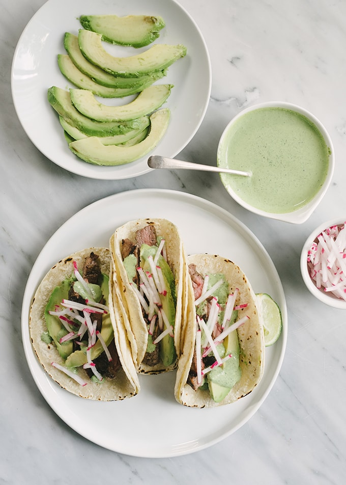 Grilled Skirt Steak Tacos with Cilantro Lime Crema - Our ...