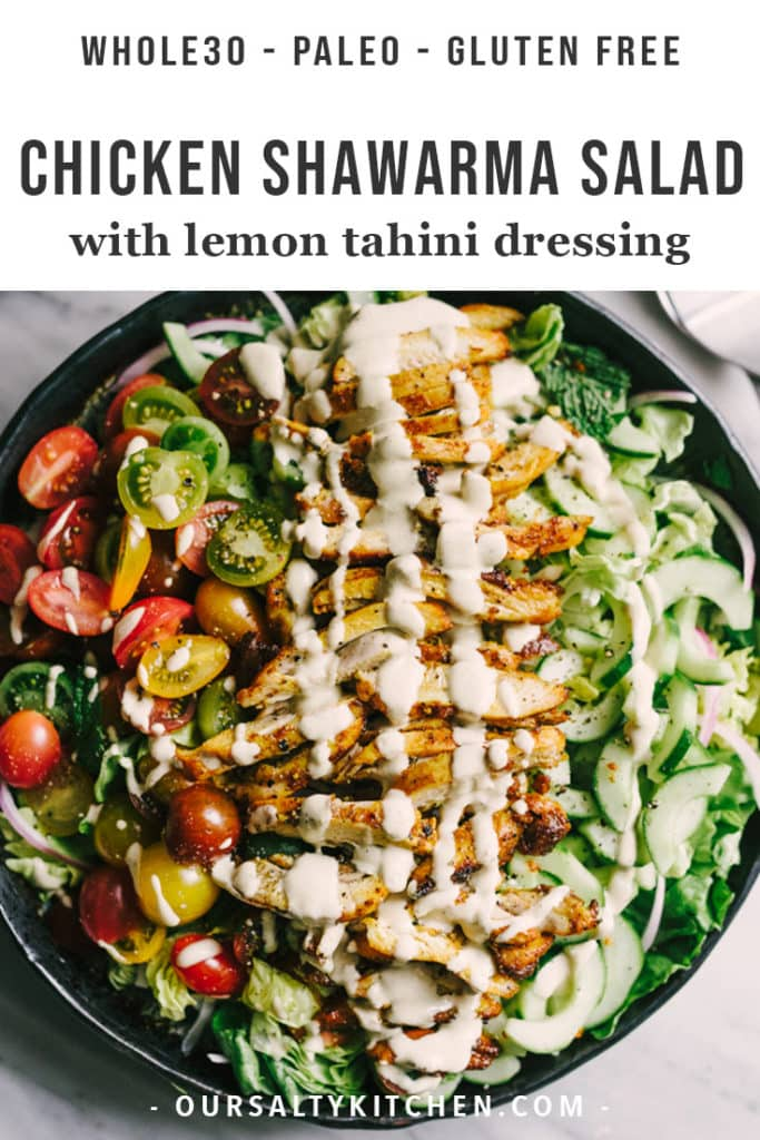 A platter of chicken shawarma salad with tomatoes, cucumbers, butter lettuce, fresh mint and parsley, and drizzled with lemon tahini dressing.