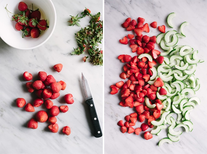 Hulled and sliced strawberries, and seeded and sliced cucumbers for strawberry cucumber salad.