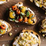 Ricotta toast is my go-to summer weeknight recipe. It's fast, easy, and SO delicious. My favorite toppings are burst tomatoes with basil, and roasted corn salsa. Both make for a refreshing, vegetarian, whole foods dinner in less than 30 minutes. #healthy #wholefood #realfood #vegetarian