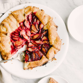 This sweet and subtle cardamom plum galette is a delicious late summer stone fruit dessert recipe. Easy, tasty, whole food dessert recipe! #wholefood #realfood #organic #recipe #stonefruit