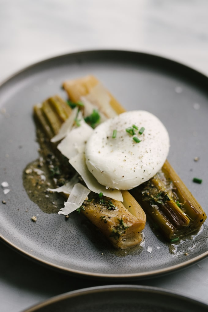 Braised leeks are incredibly simple and deceptively tasty. While perfect as a side dish, I like to turn them into a simple and nutritious whole food dinner by adding a poached egg. #wholefood #realfood #glutenfree #leeks #poachedegg