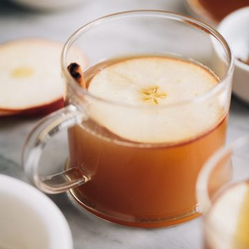 This apple cider hot toddy fall cocktail recipe is warm, soothing, sweet and spicy. It's a seasonal cocktail recipe that easily scales up and keeps perfectly warm in a crockpot for your next holiday party.