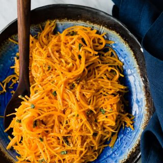 "Roasted butternut squash noodles are a vibrant and nutritious fall side dish. They are so easy to make and need only the slightest bit of seasoning to really shine. I love them ""naked"" as a light lunch or side dish, but they also make for an excellent seasonal pasta substitution. Best of all, this entire dish is ready in just 20 minutes. #grainfree #glutenfree #butternutsquash #noodles #recipe"