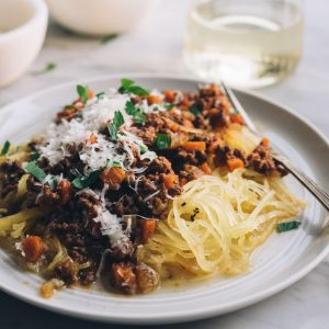 This crockpot bolognese is an easy, kid friendly gluten free meal. Packed with real, whole foods, it's a savory, hearty, weeknight meal that is perfect for chilly winter nights. Start this bolognese in the slow cooker first thing in the morning and enjoy this healthy, hearty meal after work!