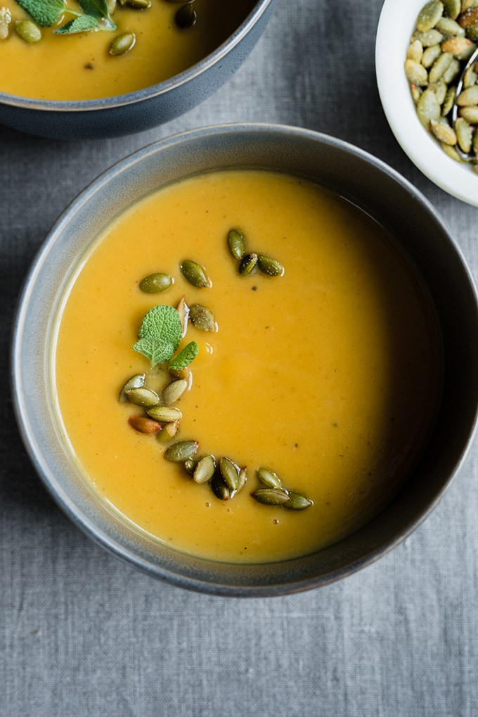 A bowl of roasted pumpkin soup. Made with coconut milk and bone broth, this paleo pumpkin soup and healthy and delicious.