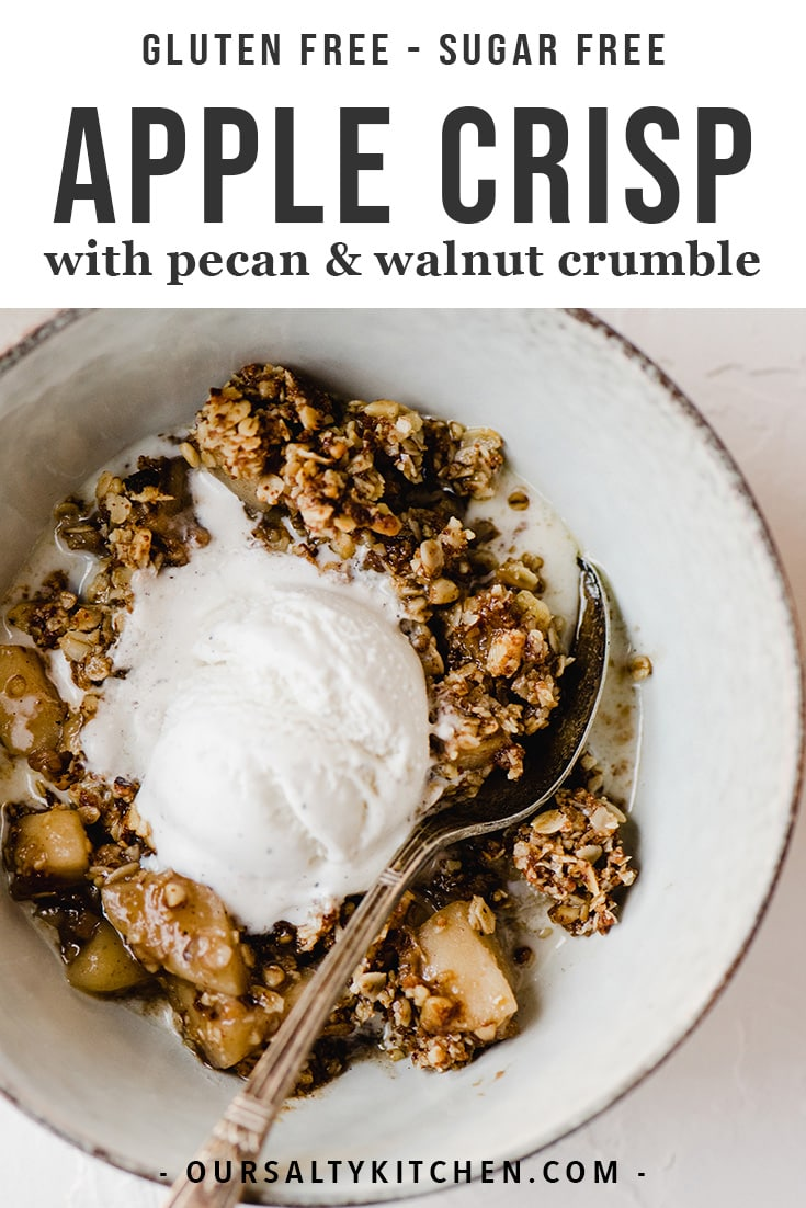 This gluten free apple crisp is a lightened up and refined sugar free version of the fall classic! It's sweetened with maple syrup and coconut sugar, and topped with gluten free oats, pecans, and walnuts. It's made start to finish in a cast iron skillet resulting in an equally tender and crisp texture. This is a healthy fall dessert recipe that will satisfy even the pickiest sweet tooth around your table.#glutenfree #sugarfree #applecrisp #thanksgiving #fall #dessert #sweets