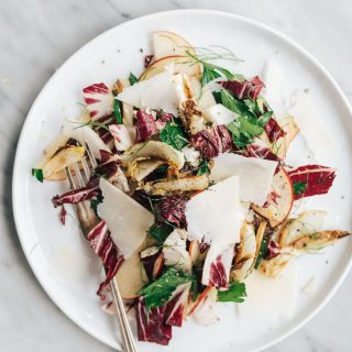 You will love this roasted fennel salad recipe! Roasted fennel is sweet and nutty and pairs perfectly with crispy apples and spicy radicchio. This easy fall salad recipe is one of my go-to paleo, Whole30 and vegan recipes when fennel is in season. It's a flavor packed side dish that's impressive enough for dinner parties and Thanksgiving dinner, but easy enough for a weeknight.