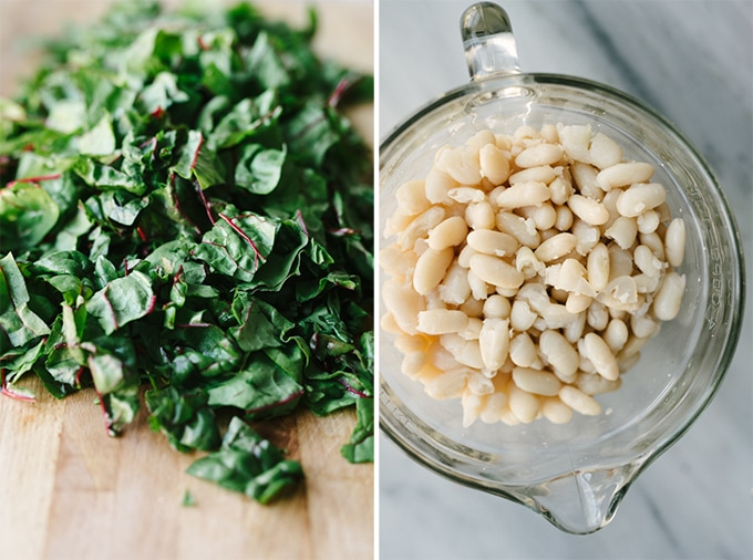How to make gluten free winter minestrone. Chopped swiss chard and white beans cooked from scratch are prepared and ready to be added to the soup after it's simmered.