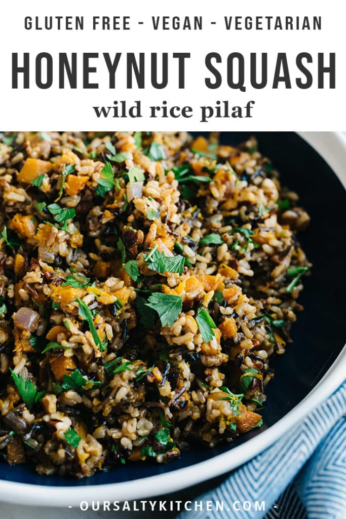 A bowl of honeynut squash wild rice pilaf on a marble table.