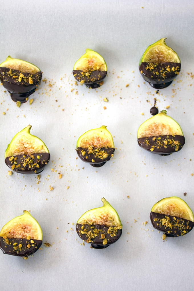 Figs dipped in chocolate with pistachio nuts - an easy, fast, make ahead cocktail party appetizer or hors d'oeuvre.