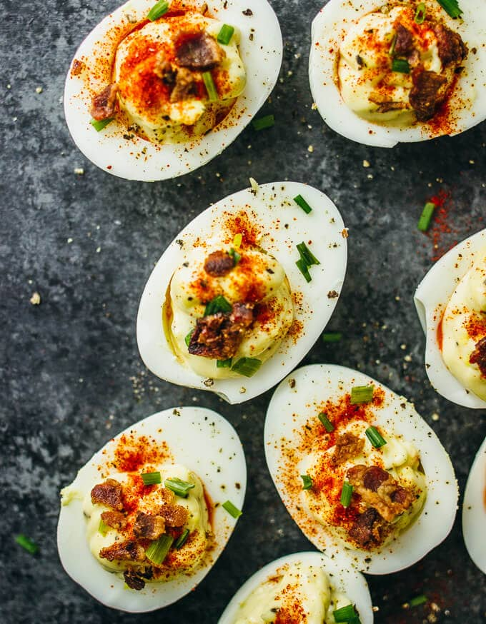 Deviled eggs on a black background - an easy, fast, make ahead cocktail party appetizer or hors d'oeuvre.