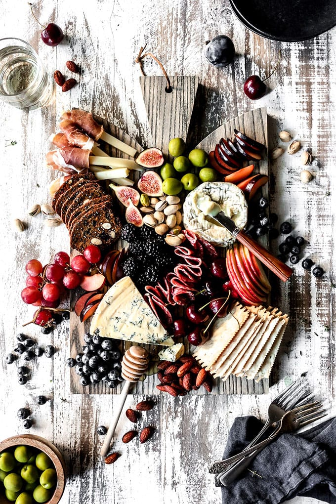 A meat, cheese, and fruit charcuterie board - an easy, fast, make ahead cocktail party appetizer or hors d'oeuvre.