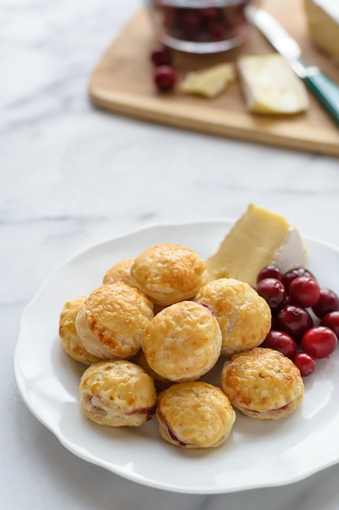 Cranberry brie bites - an easy, fast, make ahead cocktail party appetizer or hors d'oeuvre.