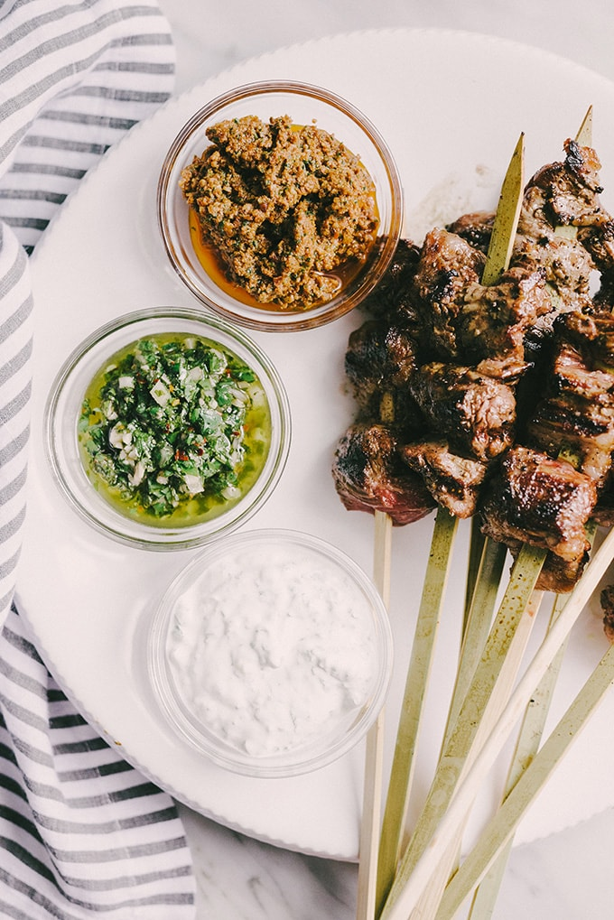 Skirt steak skewers with red, green, and white dipping sauces - an easy, fast, make ahead cocktail party appetizer or hors d'oeuvre.