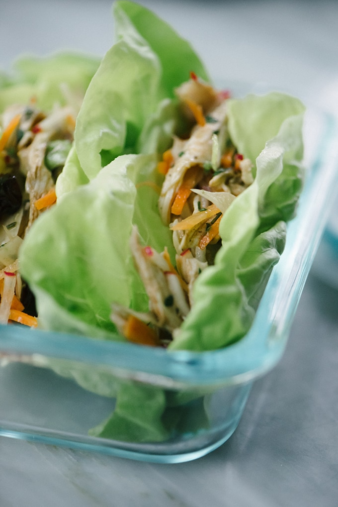 """These no mayo cherry chicken salad lettuce wraps are the perfect Whole30 """"sandwich""""! This quick and easy weekend prep recipe lasts all week, and gets better the longer it marinates. Elevate your packed lunch with this crunchy, tangy, sweet, and savory Whole30 chicken salad recipe. #whole30 #paleo #lettucewrap #lunchprep #chickensalad #nomayo #wholefoods #realfood"""