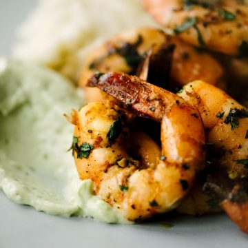 Whole30 spicy shrimp over yucca mash with avocado aioli.