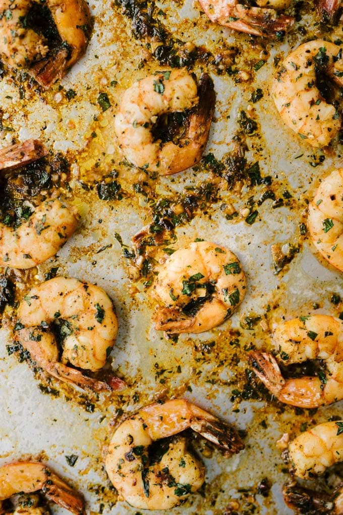 An overhead image of paleo spicy shrimp fresh from the oven on a baking sheet.