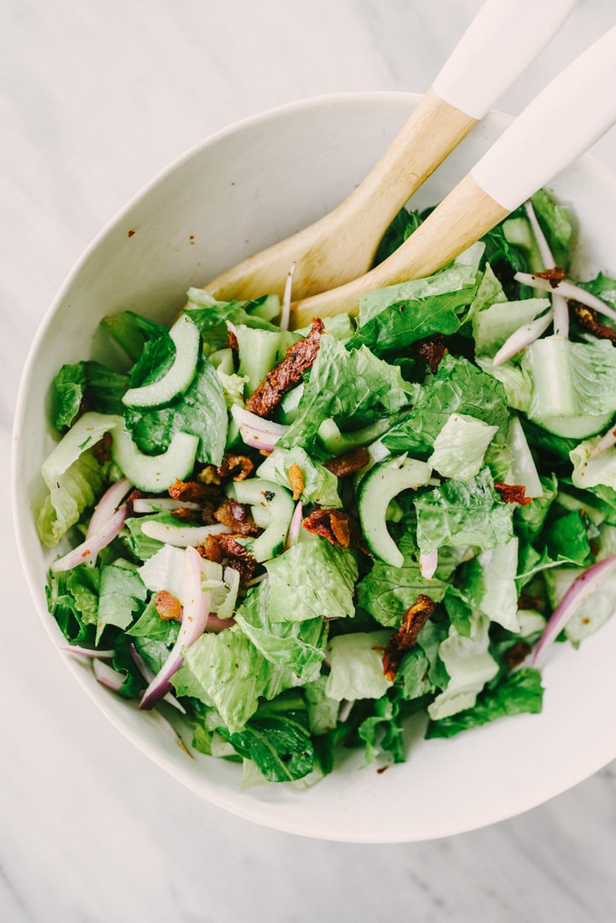 BLT chicken salad base in a large white mixing bowl with serving spoons.