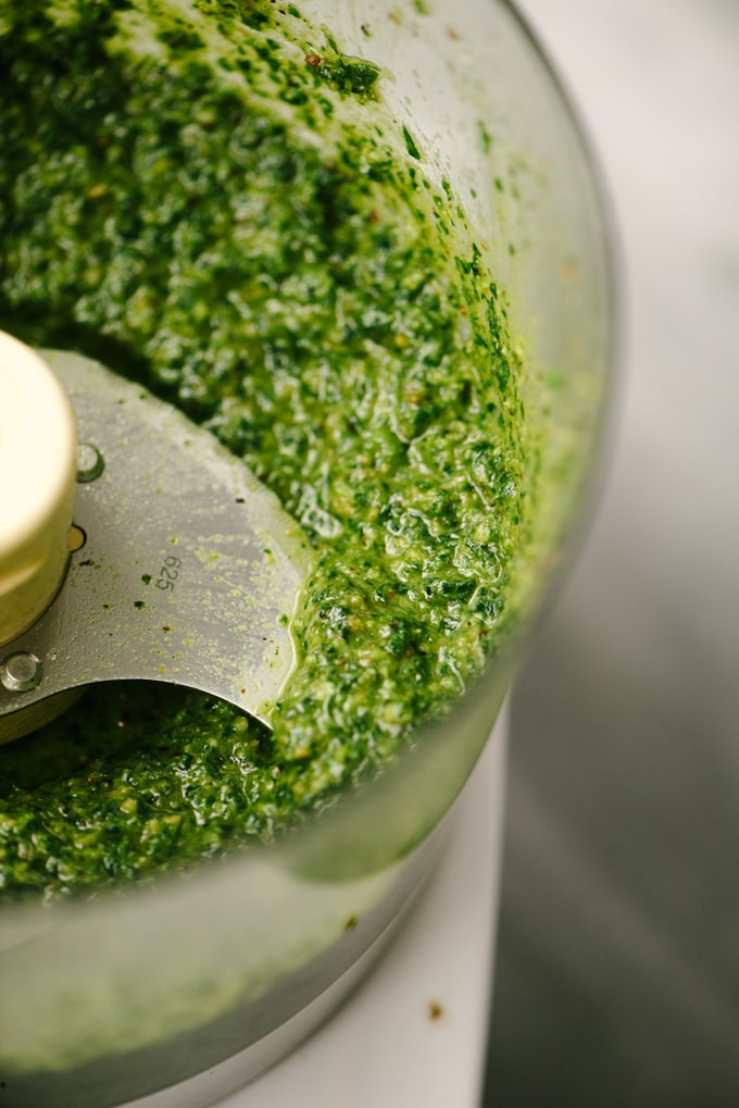 Dairy free, paleo, and Whole30 parsley pesto in a food processor.