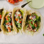 These skirt steak tacos are perfect for Taco Tuesday! They're marinated in a homemade carne asada spice blend, then grilled until crispy on the outside and tender on the inside. These easy weeknight tacos are finished with a fresh and flavorful cilantro lime sour cream sauce that quickly transforms them into the best tacos EVER. You'll love these gluten free, kid friendly skirt steak tacos!