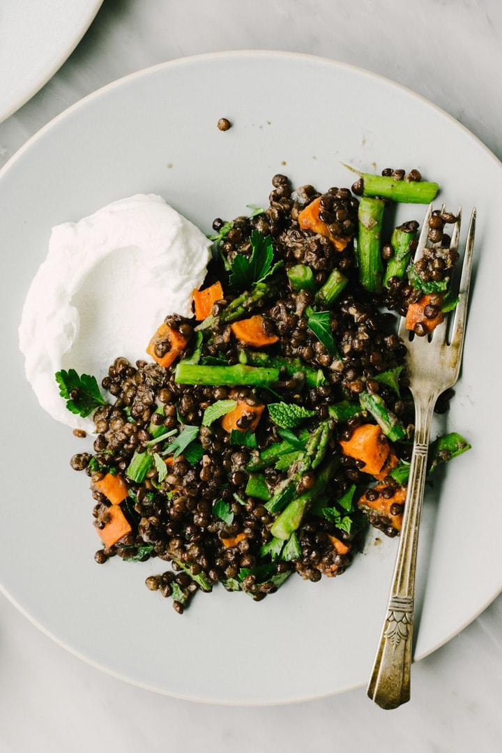 Black lentils salad with roasted vegetables and a dollop of greek yogurt.