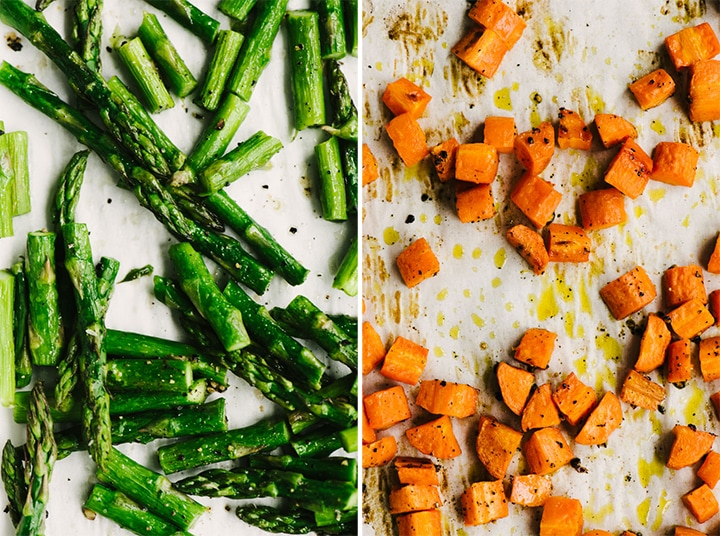 Roasted carrots and roasted asparagus on baking sheets.