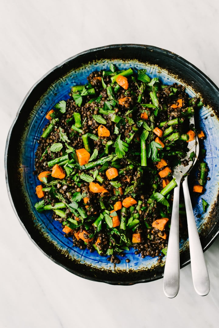 Black lentils tossed with roasted carrots, asparagus, and chopped herbs.