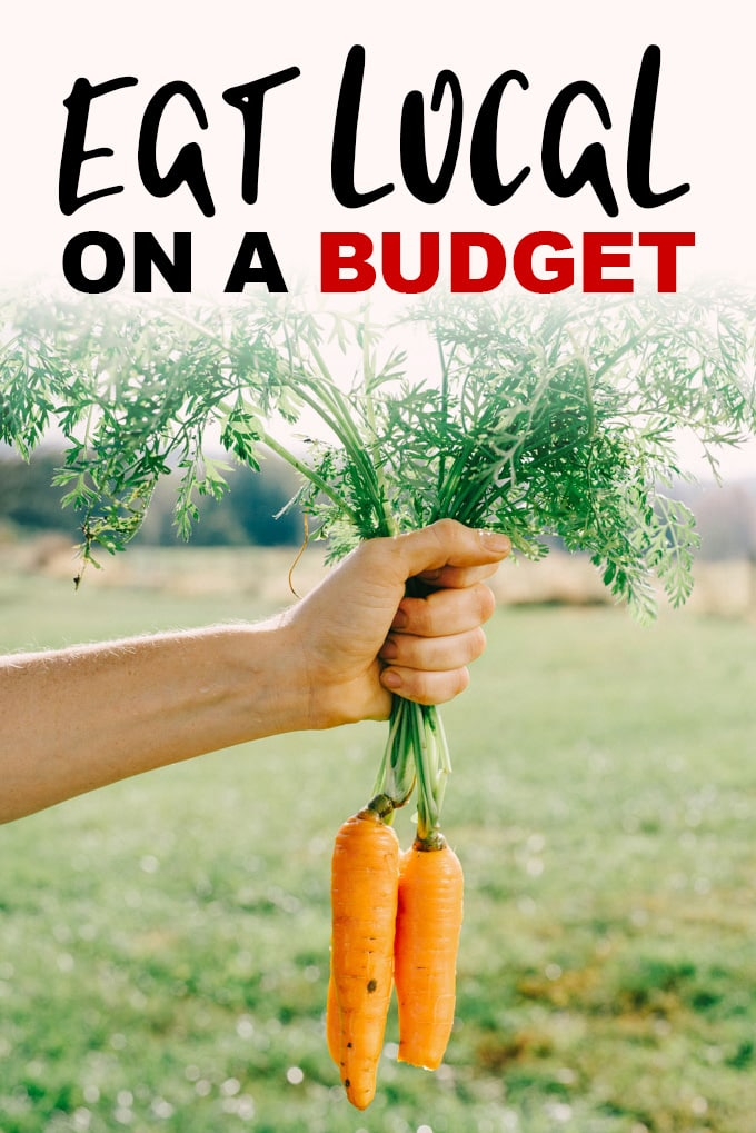 "A image of a woman holding two freshly picked carrots with the words ""Eat Local on a Budget"" laid on top."