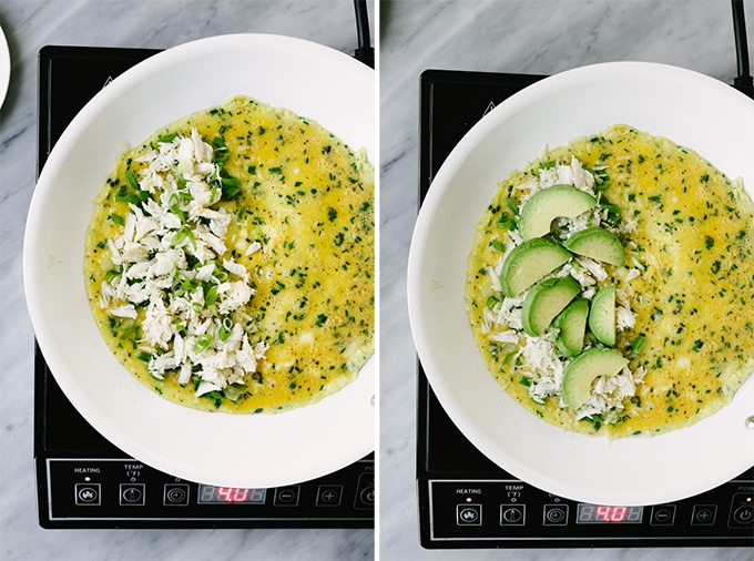 How to layer the ingredients into a crab omelet. Left, the set eggs topped with crab meat and green onions. Right, the crab meat and green onions topped with sliced avocado.