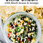 It's salsa season. Yes! For a fun and healthy twist on classic black bean salsa, try this easy version with mango, crab and cilantro. There's nothing more refreshing than crab dip for a summer picnic or potluck. It's sweet, bright, salty, and a total crowd pleaser. You'll love this easy, healthy summer salsa recipe!