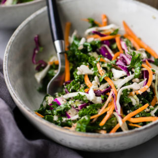 Crunchy kale slaw in a bowl served as a side salad.