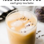 Iced london fog earl grey tea latte in a glass with fresh lavender leaves.