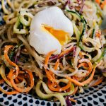 Paleo glass noodle salad with sesame ginger dressing and a poached egg.