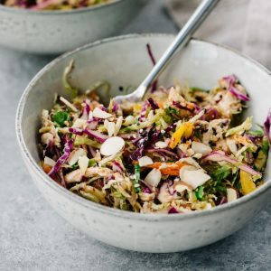 A delicious meal prep recipe! Healthy chicken salad with rainbow vegetables and no mayo almond butter dressing.