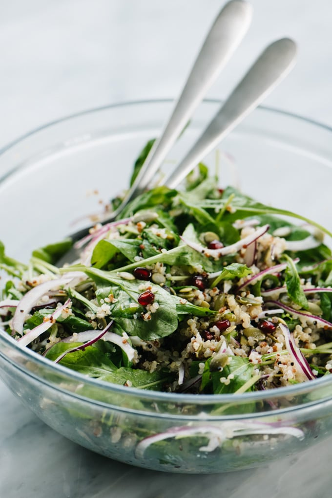 Arugula, red onion, quinoa, pomegranate seeds, and pepitas tossed with creamy maple vinaigrette.