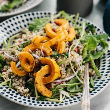 A vegetarian and gluten free delicata squash salad with creamy maple dressing.