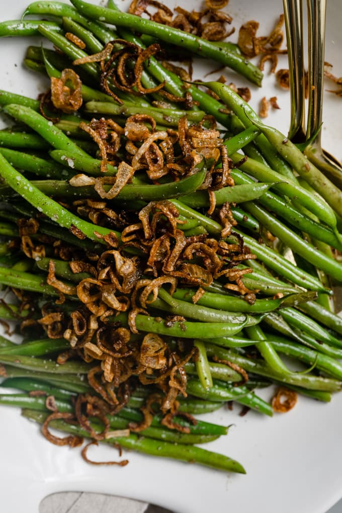 French green beans sautéed with garlic, topped with fried shallots.