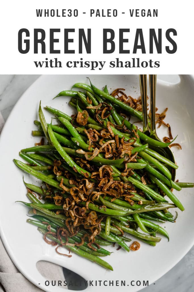 Garlicky french green beans topped with crispy shallots in a serving bowl.