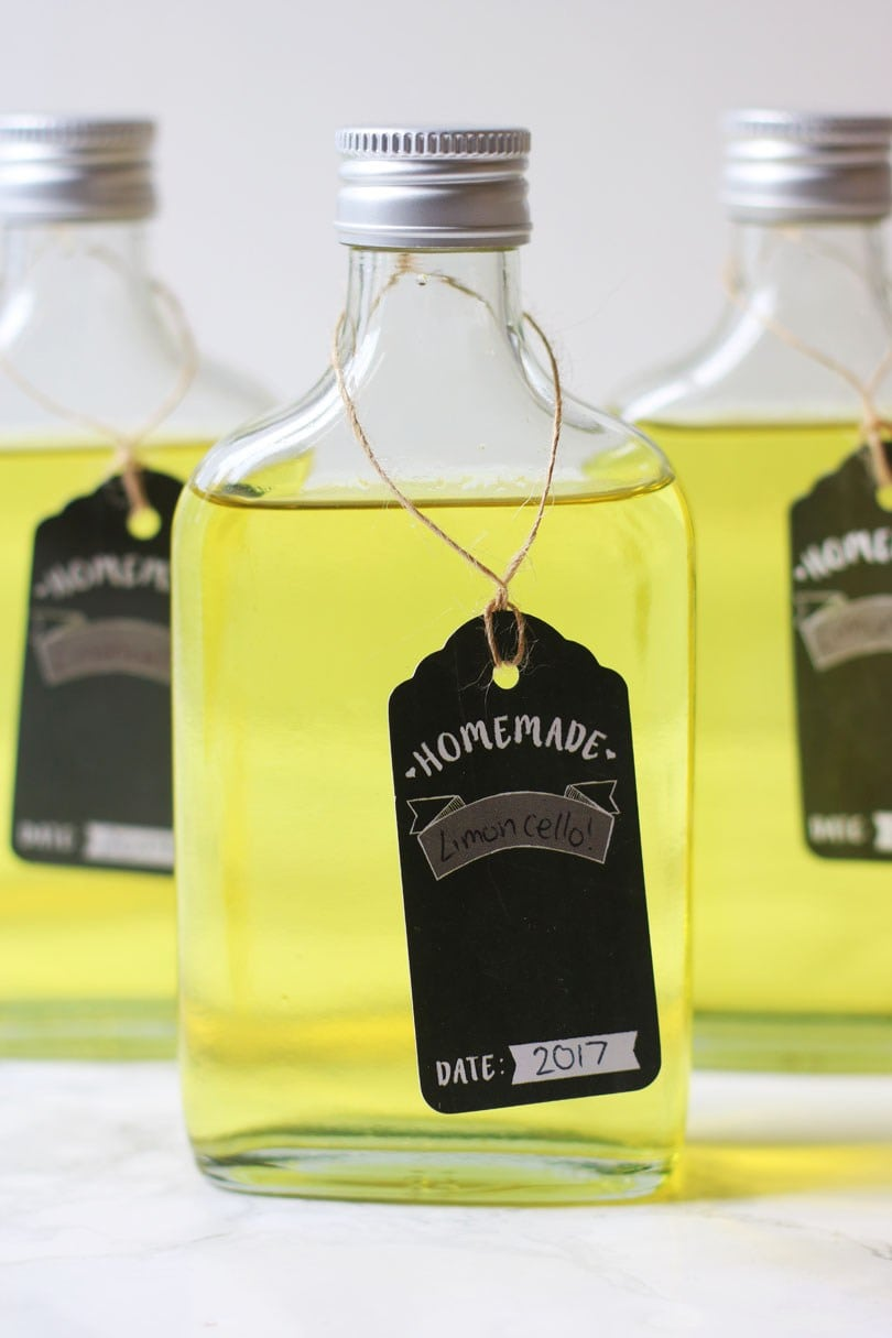 Pint bottles filled with homemade Limoncello, an easy make ahead edible Christmas gift.