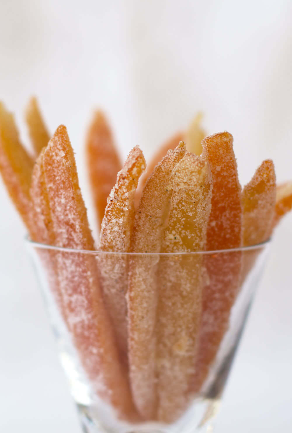 A jar filled with spiced candied orange peel, an easy and fun edible Christmas gift.