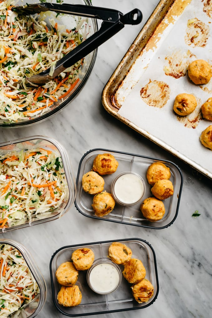 An image showing how to compose buffalo chicken meatball meal prep bowls with no mayo coleslaw.