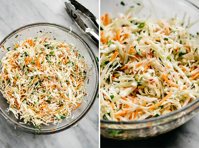 No mayo coleslaw tossed with dressing in a large mixing bowl.